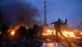 Moscow blames radicals for deadly clashes in Ukraine, EU leaders ponder sanctions against government