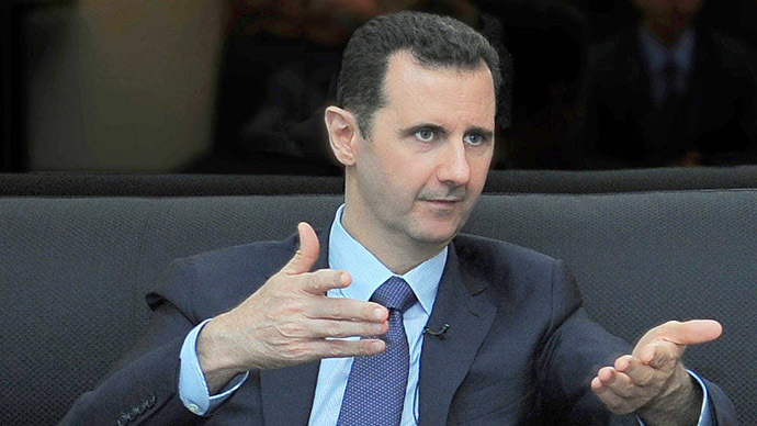 Assad: Syria to hand over chem arms in 1 month, only if US drops strike plans